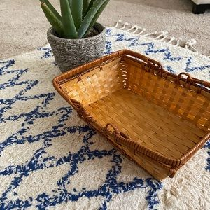 Warm brown small basket with handles basket wall